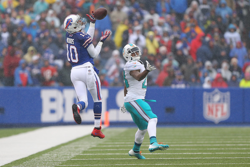 ORCHARD PARK, NY - DECEMBER 22: Robert Woods #10 of the Buffalo Bills catches a pass during NFL game action as Nolan Carroll #28 of the Miami Dolphins defends at Ralph Wilson Stadium on December 22, 2013 in Orchard Park, New York. (Photo by Tom Szczerbowski/Getty Images)